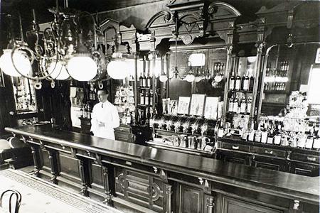 A bartender serving up New York cocktails in NoMad New York