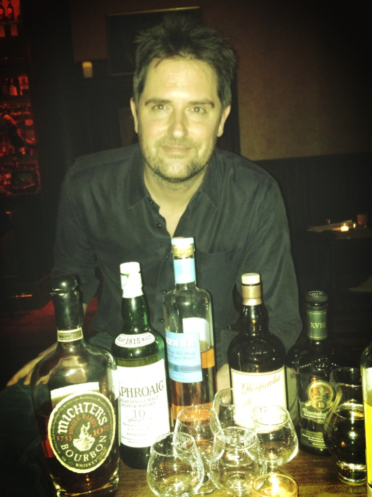 Tommy Tardie leading a whiskey tasting at the flatiron room