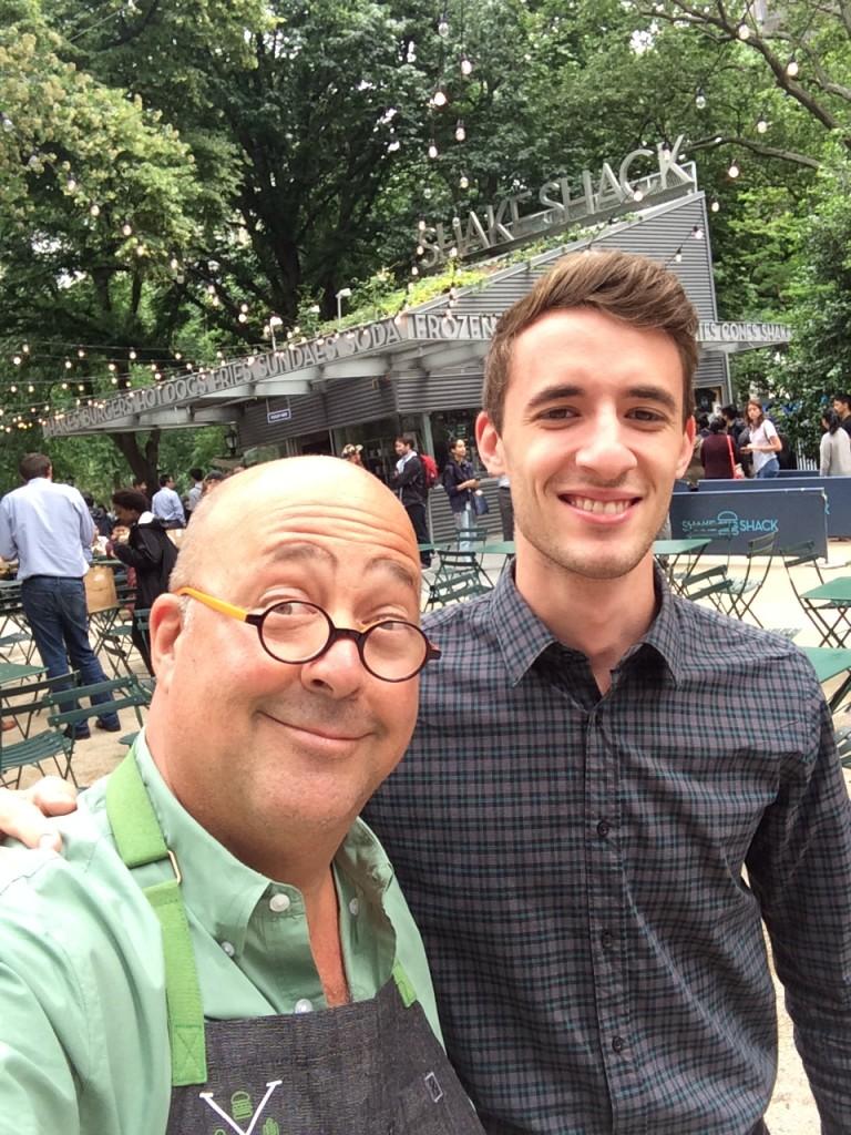 andrew zimmern poses for a selfie