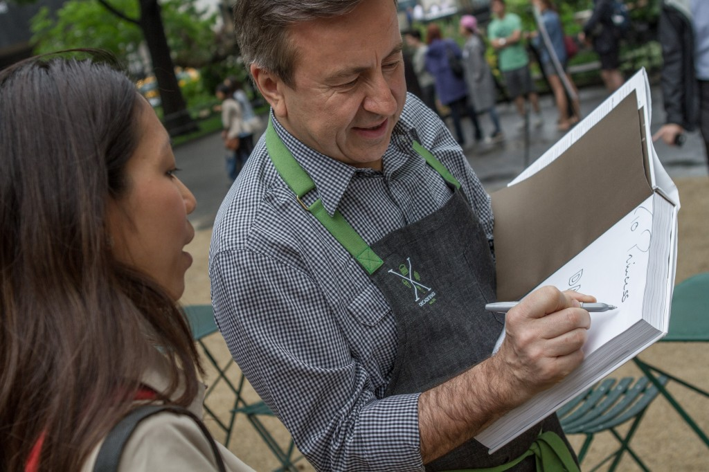Daniel Boulud signing an autograph at Shake Shack's Decade of Shack event.