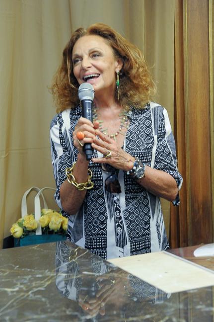 Diane von Furstenberg toasting Rizzoli at NoMad opening